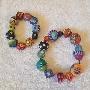 Two hand painted bead bracelets.